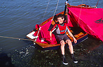 AT5BYC Young boy with his Mirror dinghy sailing boat