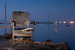 An abandoned chair is left to rust on the shore of the Salton Sea at the flooded marina in Bombay Beach, California