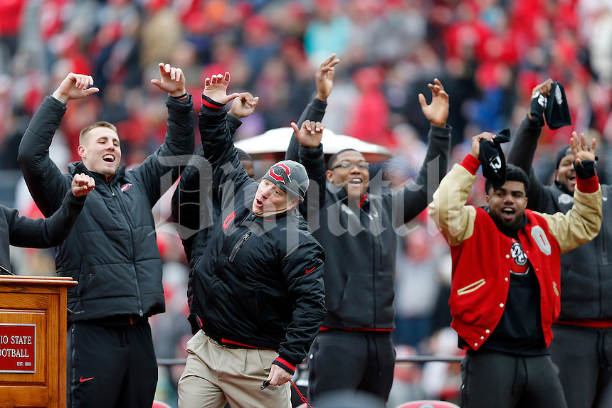 Teammates participates in the quick cal drill with assistant athletic director for football sports performance Mickey Marotti during the Ohio State football National Championship celebration at Ohio Stadium on Saturday, January 24, 2015. (Columbus Dispatch photo by Jonathan Quilter)