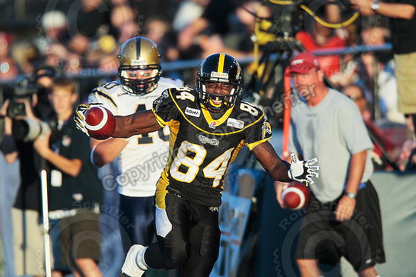 Aug 3, 2007; Hamilton, ON, CAN; Winnipeg Blue Bombers play the Hamilton Tiger-Cats at Ivor Wynne Stadium. The Tiger-Cats defeated the Blue Bombers 43-22. Mandatory Credit: Ron Scheffler. Pictured here is Hamilton Tiger-Cats wide receiver (84) Nate Curry.