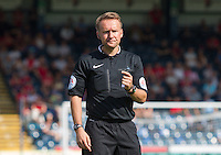 Referee Oliver Langford during the Sky Bet League 2 match between Wycombe Wanderers and York City at Adams Park, High Wycombe, England on 8 August 2015. Photo by Andy Rowland.