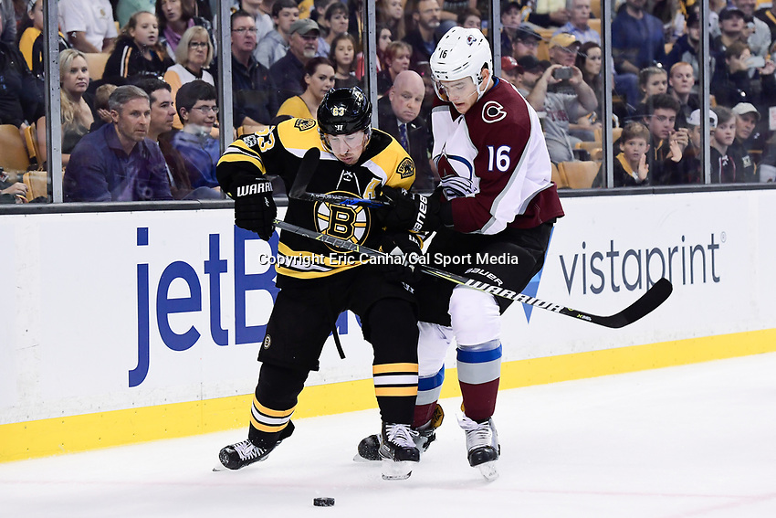 October 9, 2017: Colorado Avalanche defenseman Nikita Zadorov (16) and Boston Bruins left wing Brad Marchand (63) battle for the puck during the NHL game between the Colorado Avalanche and the Boston Bruins held at TD Garden, in Boston, Mass. Colorado defeats Boston 4-0. Eric Canha/CSM