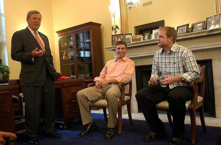 Sen. Johnny Isakson, R-Ga., speaks with Atlanta Brave right fielder Jeff Francoeur, center, and catcher Brian McCann.    Members of the team, in town for a series with the Nationals, met with the Senator and then were given a tour of the Capitol.