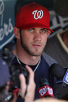 Bryce Harper #34 of the Washington Nationals before making his MLB debut against the Los Angeles Dodgers at Dodger Stadium on April 28, 2012 in Los Angeles,California. Los Angeles defeated Washington 4-3.(Larry Goren/Four Seam Images)