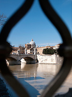 View of St. Peters Basilica through railings on Ponte Sant' Angelo, Rome, Italy