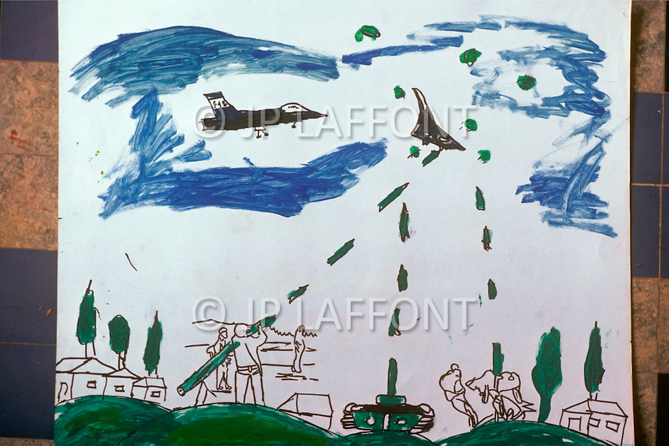 """March 1982, Lebanon: in Saïda, inside """"Acre"""" elementary school named after the city of Palestine. The naive drawings of the children reflect all the tragedy of war with Israel."""