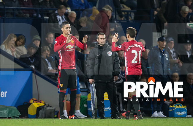 Chris Smalling of Manchester United replaces Ander Herrera of Manchester United during the EPL - Premier League match between West Bromwich Albion and Manchester United at The Hawthorns, West Bromwich, England on 17 December 2016. Photo by Andy Rowland / PRiME Media Images.