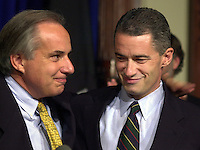 U.S. Senator Robert Torricelli (L), embraces New Jersey Governor James McGreevey (R), at a news conference in which Torricelli announced he is dropping out of the US Senate race, Monday, Sept. 30, 2002, in Trenton, New Jersey. (Photo by William Thomas Cain/photodx.com)