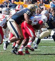 Pitt defensive lineman Aaron Donald (97) tackles New Mexico running back Crusoe Gongbay (2).The Pitt Panthers defeated the New Mexico Lobos 49-27 on Saturday, September 14, 2013 at Heinz Field, Pittsburgh, Pennsylvania.