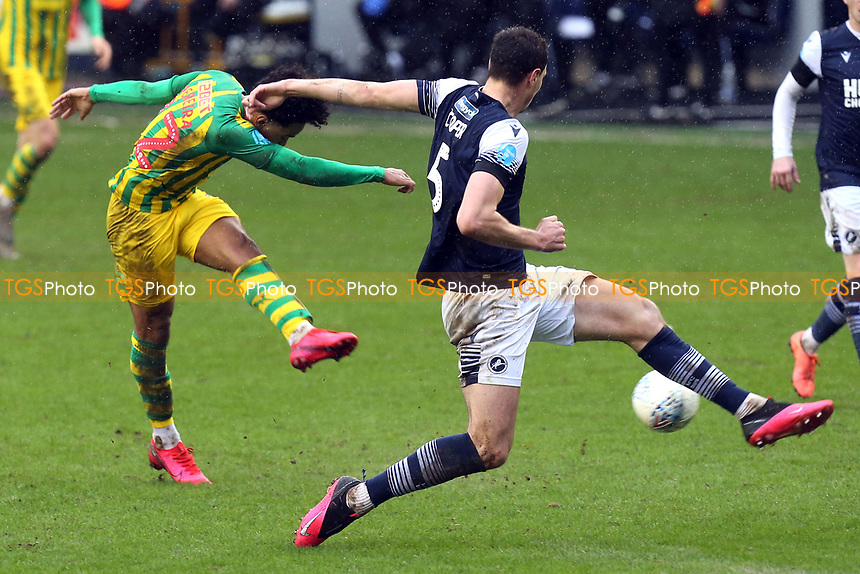 Matheus Pereira of West Bromwich Albion and Jake Cooper of Millwall during Millwall vs West Bromwich Albion, Sky Bet EFL Championship Football at The Den on 9th February 2020