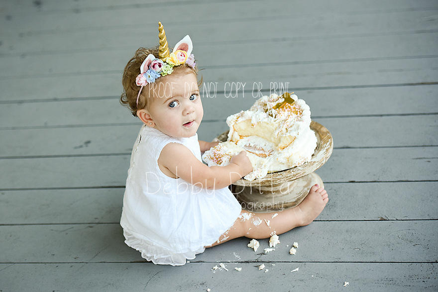 baby, newborn, child, children, family, maternity, pregnancy, photography, photographer Debby Ditta of Tomball Texas One year old baby cake smash birthday session. Professional custom boutique photography in Tomball Texas. Photographer Debby Ditta