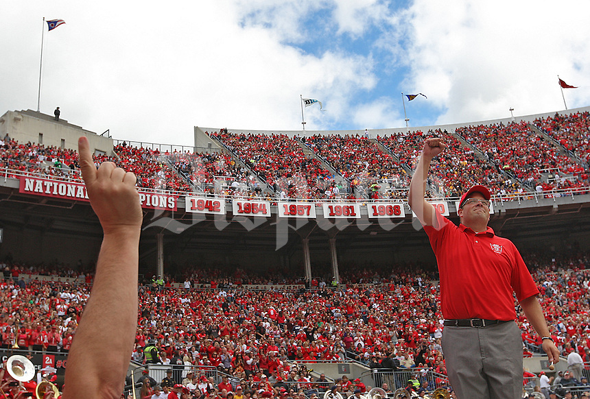 Fired OSU Marching Band Director Jon Waters acknowledges the crowds applause after directing the alumni band in the first quarter of the game against Kent at Ohio Stadium on September 13, 2014.  (Chris Russell/Dispatch Photo)