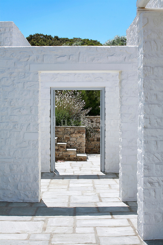 Golden sun, simple decoration and a spectacular view to the whole Aegean Sea are the main features of a stone house 330sq.m in the island of Paros in Greece.