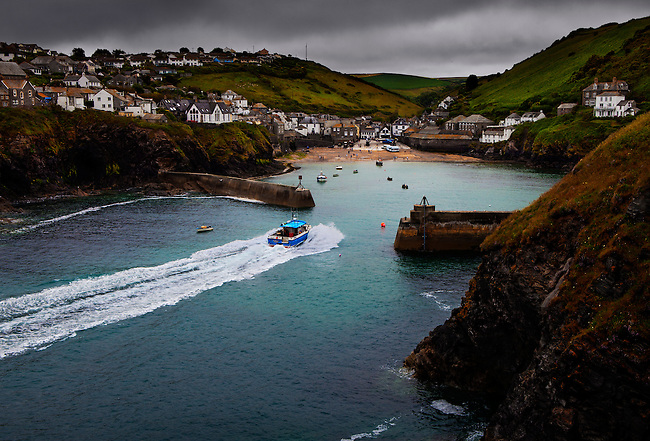 Fishing boat returning home to Port Isaac, Cornwall, U.K.<br /> <br /> Port Isaac has been a working fishing village since the early C.14th, and at one time relied heavily on catching and processing pilchards. <br /> <br /> The number of boats in the port has decreased by two thirds in the last 24 years, and the few that remain mainly catch crab and lobster. <br /> <br /> Tourism continues to play an increasingly important role in its economy, and the fishing activity is still one of its major attractions.