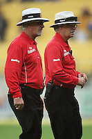 Umpires Rudi Koertzen and Evan Watkin walk off the pitch as rain stops play for the third and final time during the 2nd ODI cricket match between the New Zealand Black Caps and India at Westpac Stadium, Wellington, New Zealand on Friday, 6 March 2009. Photo: Dave Lintott / lintottphoto.co.nz