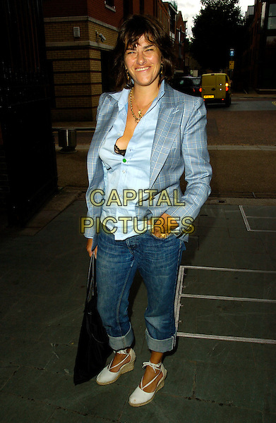 TRACY EMIN.The Mary McCartney Photography Exhibition private view, Oxo Tower Wharf, London, England..July 4th, 2007.full length tracey blue jacket shirt unbuttoned hand in pocket jeans denim rolled turned up wedges white shoes bra black bag purse .CAP/CAN.©Can Nguyen/Capital Pictures