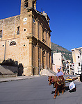 Man riding pony and cart through streets of   Castellammare del Golfo, Sicily, Italy