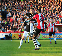 Lincoln City's Matt Rhead vies for possession with Exeter City's Hiram Boateng<br /> <br /> Photographer Chris Vaughan/CameraSport<br /> <br /> The EFL Sky Bet League Two Play Off Second Leg - Exeter City v Lincoln City - Thursday 17th May 2018 - St James Park - Exeter<br /> <br /> World Copyright &copy; 2018 CameraSport. All rights reserved. 43 Linden Ave. Countesthorpe. Leicester. England. LE8 5PG - Tel: +44 (0) 116 277 4147 - admin@camerasport.com - www.camerasport.com