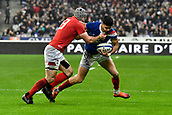 February 1st 2019, St Denis, Paris, France: 6 Nations rugby tournament, France versus Wales;  Romain Ntamack (fr) is tackled by Jonathan Davies