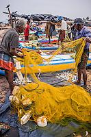 Negombo fish market (Lellama fish market), photo of fishermen checking their catch, Negombo, West Coast of Sri Lanka, Asia. This is a photo of fishermen checking their catch at Negombo fish market (Lellama fish market), Negombo, West Coast of Sri Lanka, Asia.