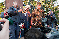 Sandor Pinter (3rd L) minister of internal affairs speaks on the stage during an anti-government rally of firemen and other law enforcement workers who protest in front of the Parliament against the government's austerity measures in Budapest, Hungary on May 06, 2011..The government has launched a package of fiscal reforms to cut the budget deficit, including scrapping early retirement, which mostly affects law enforcement personnel. ATTILA VOLGYI