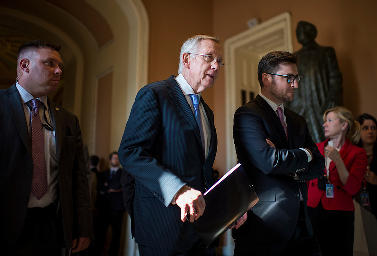 UNITED STATES - JULY 15: Senate Majority Leader Harry Reid, D-Nev., walks from the Senate floor to the Old Senate Chamber for the all-Senate Joint Conference on the filibuster on Monday, July 15, 2013. (Photo By Bill Clark/CQ Roll Call)