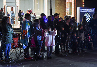 """NWA Democrat-Gazette/CHARLIE KAIJO Parade attendees watch as a parade goes by, Saturday, November 30, 2019 during an annual Christmas parade along Emma Ave. in Springdale.<br /> <br /> Floats, bands and Santa greeted visitors for the 23rd annual Christmas parade. This year's theme was """"Christmas Vacation"""". The parade started at Parsons Stadium and headed west on Emma Avenue, concluding at Harris Street."""