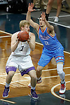 SIOUX FALLS, SD - MARCH 9:  Jake Bruner #3 from the College of Idaho tries to make a move against Collin Kramer #12 from Dakota Wesleyan during their second round game at the 2018 NAIA DII Men's Basketball Championship at the Sanford Pentagon in Sioux Falls. (Photo by Dick Carlson/Inertia)