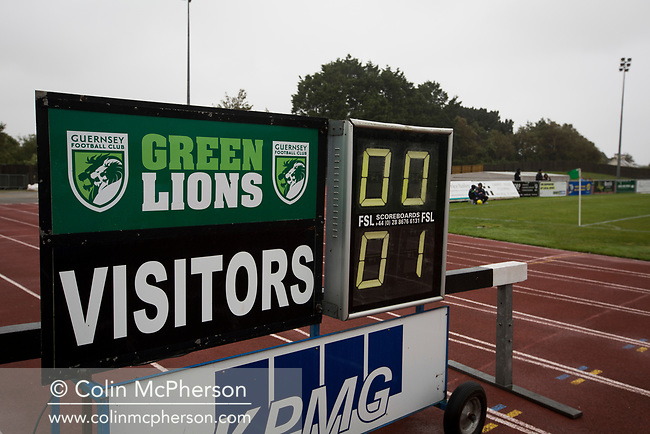 The stadium scoreboard shows the scoreline late in the second-half as Guernsey take on Corinthian-Casuals in a Isthmian League Division One South match at Footes Lane. Formed in 2011, Guernsey FC are a community club located in St. Peter Port on the island of Guernsey and were promoted to the Isthmian League Division One South in 2013. The visitors from Kingston upon Thames won the fixture by 1-0, watched by a crowd of 614 spectators.