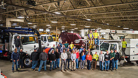 Minnesota's City of Hopkins employees and department heads from the Public Works Department stand with fellow local government employees inside the vehicle maintenance hangar and garage where the Streets, Forestry service, water and sewer, and other City of Hopkins public service vehicles are housed.