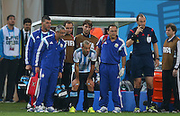 Javier Mascherano of Argentina waits to come back on after suffering a head injury
