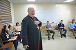 Cardinal Timothy Dolan, archbishop of New York and chair of the Catholic Near East Welfare Association, laughs as he talks with students in a class in the Catholic University in Ankawa, near Erbil, Iraq, on April 11, 2016.