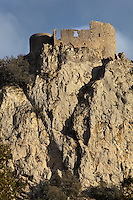 "Old keep of the Lower Castle, Peyrepertuse Castle or Chateau Pierre Pertuse, Cathar Castle, Duilhac-sous-Peyrepertuse, Corbieres, Aude, France. This castle consists of a Lower Castle built by the Kings of Aragon in the 11th century and a High Castle built by Louis IX in the 13th century, joined by a huge staircase. Its name means pierced rock in Occitan and it has been associated with the Counts of Narbonne and Barcelona. It is one of the ""Five Sons of Carcassonne"" or ""cinq fils de Carcassonne"" and is a listed monument historique. This view shows the steep cliffs which are a natural defense. Picture by Manuel Cohen"