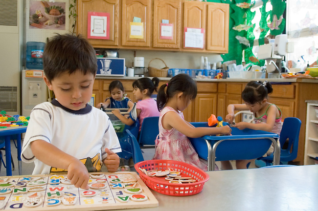 Berkeley CA  Children ages three and four in cooperative, parallel and solitary play at Spanish-English bilingual preschool