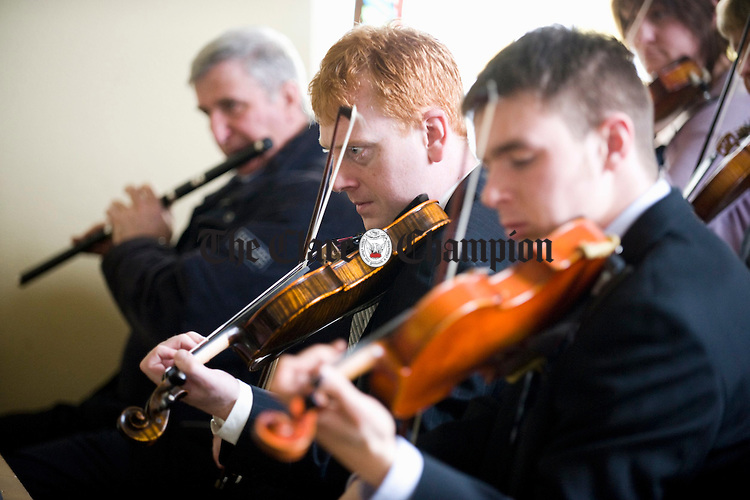 Johnny Kelly and  Johnny Kelly, centre, playing at the funeral of Joe Ryan in Inagh.