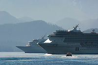Tourists are transported to cruise ships that are moored in Sitka Sound, Sitka, Southeast Alaska.