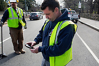 John Mullaney, temporary supervisor for construction for the Boston Public Works Department, takes a photo of repair work done by his crew in Boston, Massachusetts, USA, on April 12, 2012.  The city uses a computer system to track public complaints and record work done by city crews to mitigate these complaints.  A supervisor or inspector photographs before and after pictures of the work in addition to making notes about the work done.