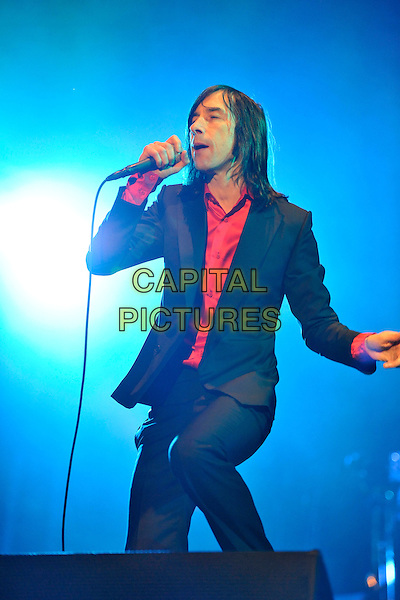 PRIMAL SCREAM - BOBBY GILLESPIE.Performing live in concert to celebrate the 20th Anniversary of the band's classic album 'Screamadelica' at Olympia Exhibition Centre, London, England, UK, November 27th, 2010..on stage music gig band half length black red shirt suit microphone singing jacket .CAP/MAR.© Martin Harris/Capital Pictures.