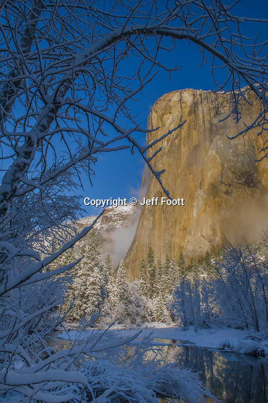 El Capitan and the Merced River in Yosemite National Park with new snow.