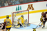 09 APR 2011: Michigan Wolverines goalie Shawn Hunwick (31) watches the shot of Minnesota-Duluth Bulldogs Kyle Schmidt (7) get past him in the first overtime during the Division I Men's Ice Hockey Championship held at the Xcel Energy Center in St. Paul, MN. Minnesota-Duluth beat Michigan in overtime, 3-2 to claim the national title. Vince Muzik/ NCAA Photos