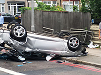 Pictured: The silver Hyundai car which toppled over onto its roof in the Northolt area of London, England, UK. Friday 26 July 2019<br /> Re: A car toppled over on Church Road in the Northolt area of London at approximately 13.30. The silver Hyundai car landed on its roof with its bonnet resting on the adjacent pavement.