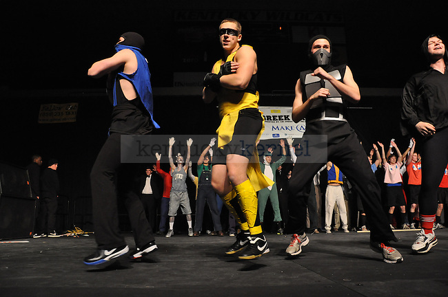 """Members of Beta Theta Pi perform their fraternity's theme, """"Gametime,"""" during Greek Sing 2012 at Memorial Coliseum in Lexington, Ky., on Saturday, Feb. 11, 2012. Beta won the fraternity division for second year in a row. Photo by Taylor Moak 