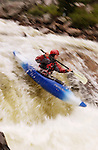 Bill Coar kayaks in the whitewater of the Narrows on the Poudre River, Colo., June 27, 2004.
