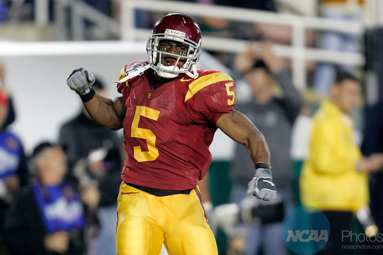 04 JAN 2006:  Reggie Bush (5) of the University of Southern California celebrates his touchdown against the University of Texas during the BCS National Championship Game at the Rose Bowl in Pasadena, CA.  Texas defeated USC 41-38 for the national title.  Jamie Schwaberow/NCAA Photos