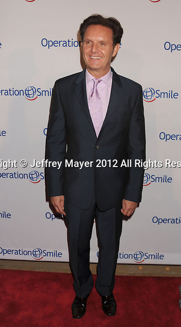 BEVERLY HILLS, CA - SEPTEMBER 28: Mark Burnett attends Operation Smile's 30th Anniversary Smile Gala - Arrivals at The Beverly Hilton Hotel on September 28, 2012 in Beverly Hills, California.