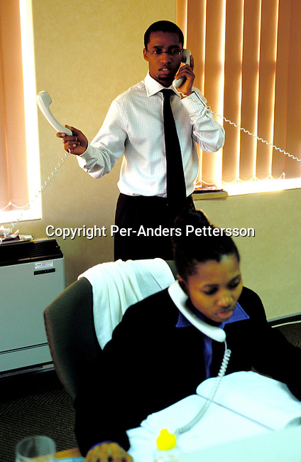 dibucor00043 Business Corporate. Andile Mazwai, a young black successful businessman and the only black stockbroker in South Africa, talking to clients in his office on May 13, 2002 in Rosebank Johannesburg, South Africa. Black empowerment, telephone.©Per-Anders Pettersson/iAfrika Photos.