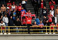 BOGOTÁ - COLOMBIA, 31–03-2019: Hinchas de Deportivo Independiente Medellín, animan a su equipo durante partido de la fecha 12 entre Millonarios y Deportivo Independiente Medellín, por la Liga Águila I 2019, jugado en el estadio Nemesio Camacho El Campín de la ciudad de Bogotá. / Fans of Deportivo Independiente Medellin, cheer for their team during a match of the 12th date between Millonarios and Deportivo Independiente Medellin, for the Aguila Leguaje I 2019 played at the Nemesio Camacho El Campin Stadium in Bogota city, Photo: VizzorImage / Luis Ramírez / Staff.