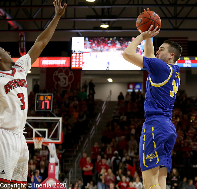 VERMILLION, SD - JANUARY 19: Alex Arians #34 of South Dakota State Jackrabbits spots up for a three pointer against the South Dakota Coyotes at the Sanford Coyote Center on January 19, 2020 in Vermillion, South Dakota. (Photo by Dave Eggen/Inertia)