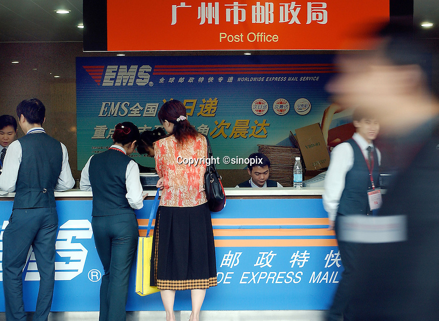A post office offers express mail service called EMS in Guangzhou, China..28-OCT-04