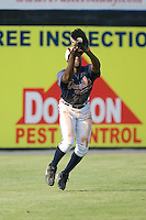 Left fielder Kuyaunnis Miles (9) of the Danville Braves catches a fly ball at Dan Daniels Park in Danville, VA, Sunday July 27, 2008.